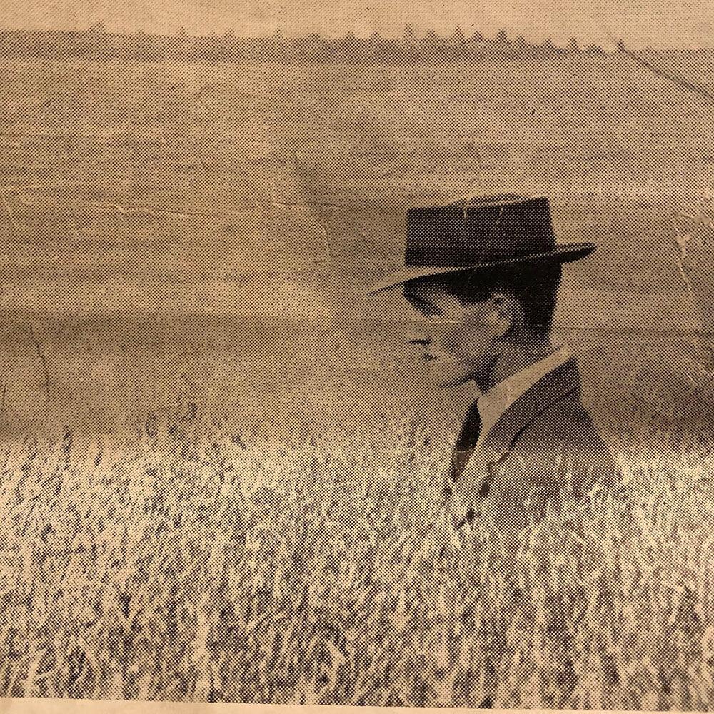 Logie farmer with hat on in field